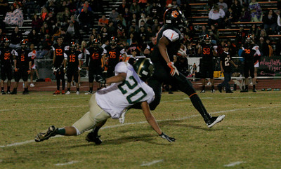 Woodlake Tiger Elijah Cunningham (1) breaks past Derek Yang (20) in route to a 67 yard touchdown catch.