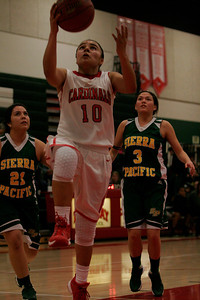 Sierra Pacific Golden Bear players Leticia Acevedo (21)  and Maegan Harding watch as Lindsay's Christina Castro shoots a layup for 2 of her 23 points.