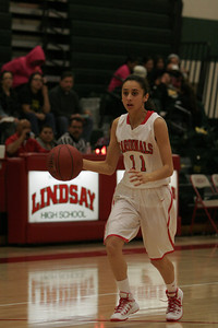 Linsday Cardinal Megan Salinas (11) brings the ball up during the Cardinals' 72-40 win over Sierra Pacific on February 6, 2014.