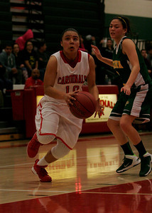 Lindsay Cardinals guard Christina Castro drives around Sierra Pacific Golden Bear Maegan Harding for 2 of her 23 points.