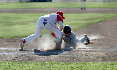 Sierra Pacific's Connor Mannix dives back during a pick-off attempt against Lindsay on 4-9-13.