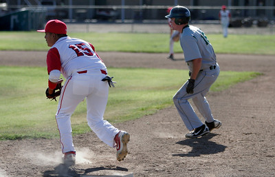 Lindsay First Base's Victor Espinoza holds Sierra Pacific's Connor Mannix during Tuesday, April 9th game.