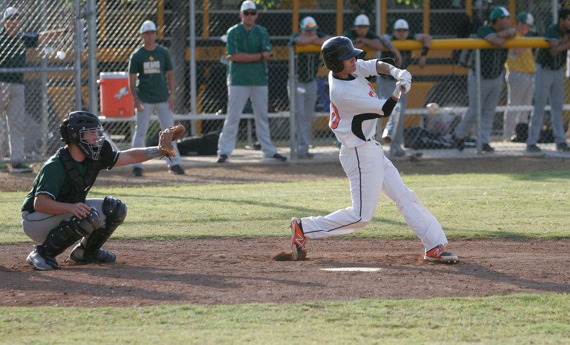 Woodlake SS Eddie Pena chases a pitch from Sierra Pacific pitcher Jacob Evangelo in the Tigers' 4-0 loss to the Golden Bears on May 7, 2014.