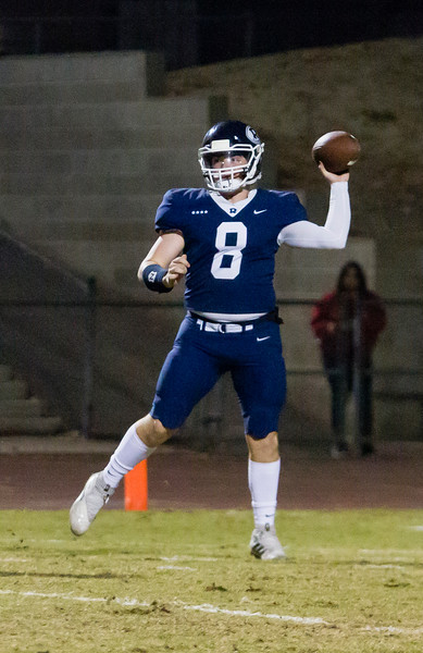 Redwood Ranger QB Ryan Rios (8) drops back to pass against the St. Joseph Knights in CIF Central Section D2 Football playoff action.