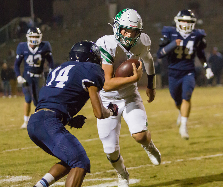 St. Joseph Knight QB  Hunter Barnhart (7) rushes toward Redwood Ranger CB Malachi Aguilar (14) in Friday night's CIF Central Section D2 playoff contest. The Knights would end the Ranger season with a 28-21 win.