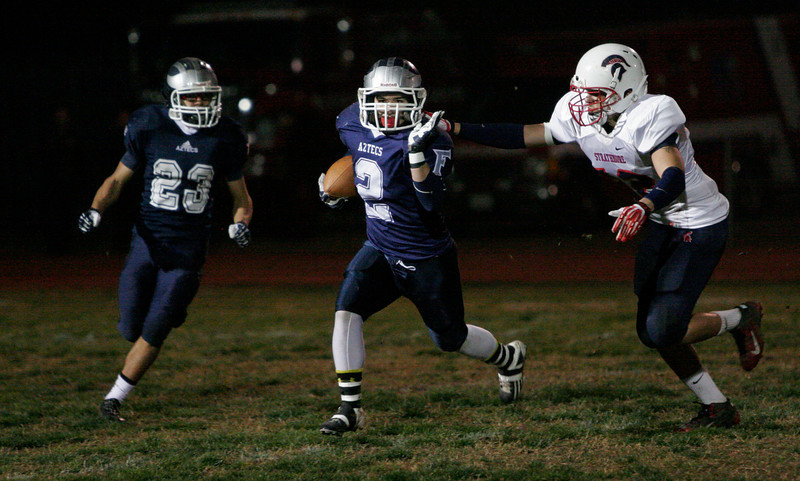 Farmersville FB Anthony Azevedo (2) carried the ball 13 times for 53 yards and a touchdown against the Strathmore Spartans in Friday's Division VI Valley final.