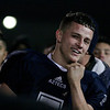 Farmersville quarterback Sam Metcalf listens as Coach David Lewis congratulates his team on their Valley Champioship.