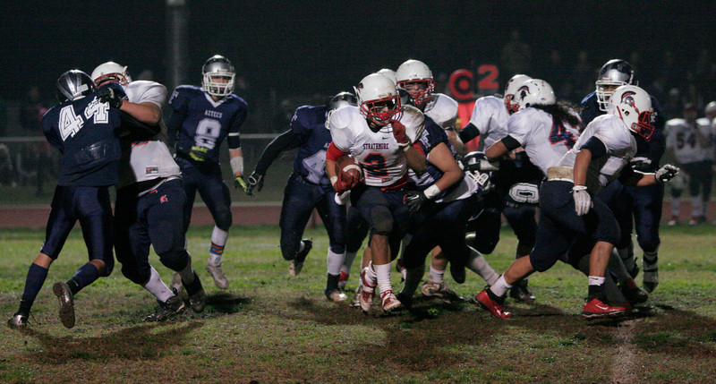 Strathmore Spartan RB breaks through the line in their 47-35 loss to the Farmersville Atzecs in the Division VI final.