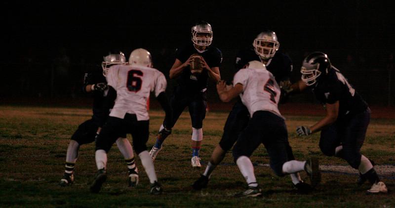 Farmersville Aztec quarterback Sam Metcalf (7) surveys the field from the pocket in the Aztec's 47-35 win.