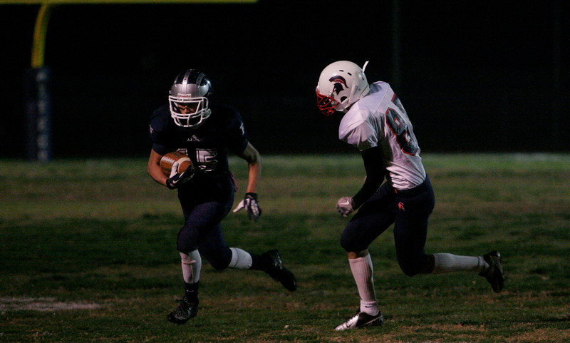 Farmersville WB rushes the football early in the Atzec's Sectional final against Strathmore Spartans.
