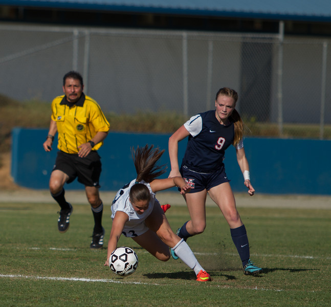 Strathmore Spartan standout forward Samantha Oliveria takes a tumble during the 2015 CIF Southern California Division IV soccer championship final as Maranatha Minuteman Katy Coats (9) looks on. The Minutemen came away with a 3-1 victory.