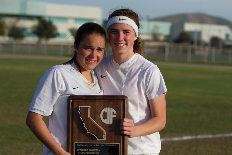 Strathmore Spartan soccer standouts (l to r) Samantha Oliveira and Ally Holloway pose with the plaque awarded to the Spartans as the 2nd Place finishers in the 2015 CIF Division IV Southern Region Championship.