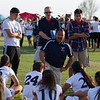 Strathmore Spartan girl's soccer coach Hector Gonzalez speaks to his team after their 3-1 loss in the final of the 2015 CIF Southern Region Division IV final.  Gonzalez reminded them of all that they had accomplished during the season.