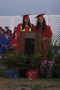 Strathmore High School graduates Maria Fernandez (l) and Lauren Johnson (r) welcome parents, famililes, and friends to the Strathmore 2013 Commencement on May 24, 2013.
