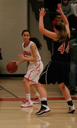 Strathmore's Coby Duffin (44) guards Lindsay Cardinal Megan Salinas (11) during their contest on Friday, February 21.