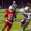 Strathmore Spartan DE Adam Ceballos (53)  attempts to tackle Lindsay Cardinal RB Isiah Garcia (20) in Friday night CSL play. Lindsay would go on to a 10-7 victory over the Spartans.