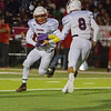 Strathmore Spartan QB Trace Pugh (8) hands the ball off to Spartan RB Cristian Rodriguez (3) during their contest against the Lindsay Cardinal in Central Sequoia action. The Cardinal would win 10-7 to spoil Strathmore's perfect season.