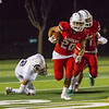 Lindsay  Cardinal RB Isiah Garcia (20) rushes the football past Strathmore Spartan defender Lee Navarro (2) in CSL play. Lindsay would go on to defeat the previously undefeated Spartans by a 10-7 score.