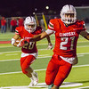 Lindsay Cardinal RB Daniel Trujillo (21) leads fellow Cardinal RB Isiah Garcia (20) around the end against the Strathmore Spartans.  Lindsay came away with a 10-7 victory over the previously unbeaten Cardinals.