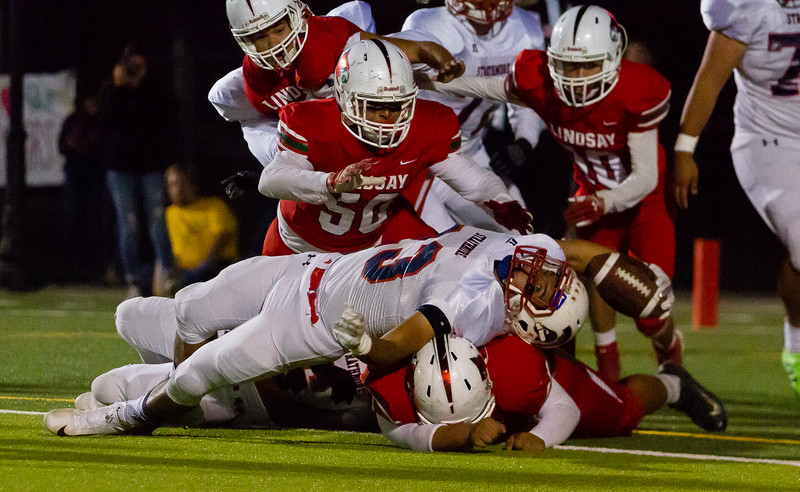 Strathmore Spartan RB  stretches for the goal line early in their contest against the Lindsay Cardinals. The Cardinals would hold on and keep Strathmore out of the endzone. Lindsay would go on to win the contest 10-7.