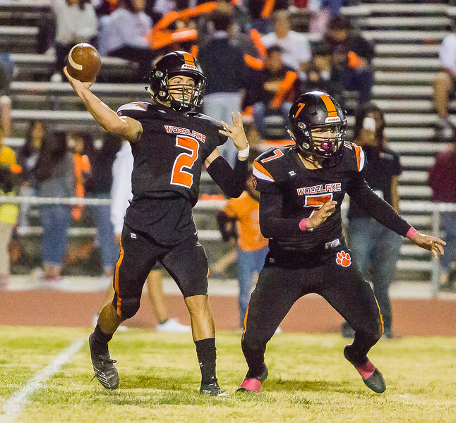 Woodlake Tiger QB Damian Hernandez (2) throws a pass down field during the Tigers' Homecoming football game against the Strathmore Spartans. The Tigers would loss a hard fought battle by a 26-22 score.