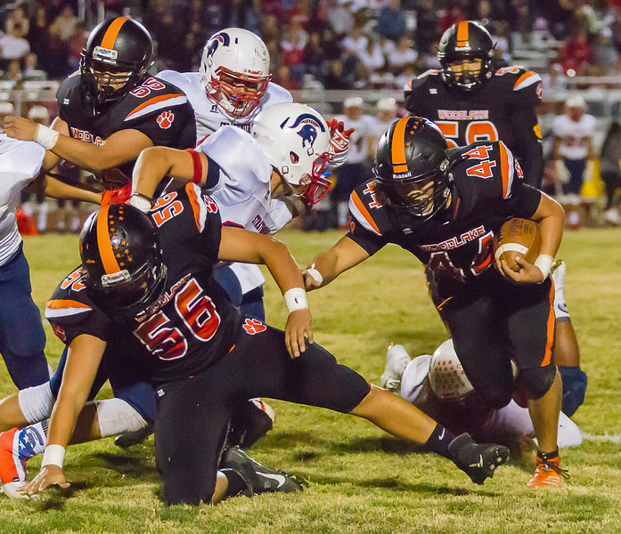 Woodlake Tiger RB Saul Palomo (44) runs for tough yards in the Tigers 26-22 loss to the visiting Strathmore Spartans