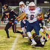 Strathmore RB Christian Osurez (6) eludes an ankle tackle in Strathmore's 26-22 victory over the Woodlake Tigers.