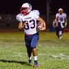 Strathmore Spartan senior running back  Joseph Garcia (33) ran for 115 yards on 3 carries, including a 76 yard touchdown run, in the Spartan's 42-6 trouncing of the host Farmersville Aztecs in both teams season opener.