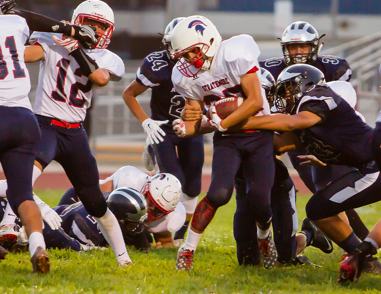 Strathmore Spartan running back Fabian Alcantar (27) fights for tough yardage during the Spartan's 46-2 victory over the host Farmersville Aztecs during the season opener.