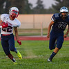 Farmersville Aztec Brian Macias (53) attempts to run down Strathmore Spartan RB Alonso Acevedo during their non-league contest on Friday. The Spartans rolled to a 42-6 victory.