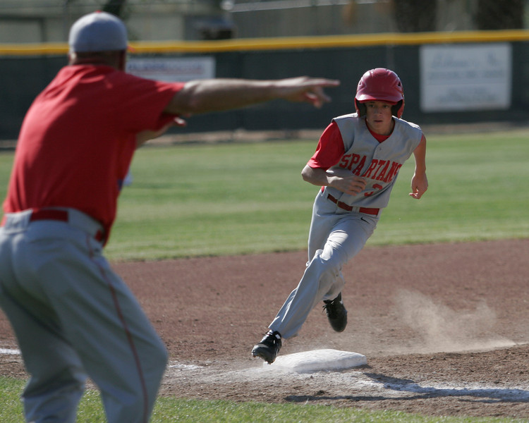 Strathmore Spartan Brandon Belk turns for home during their season finale at Lindsay on Friday, May 9, 2014.