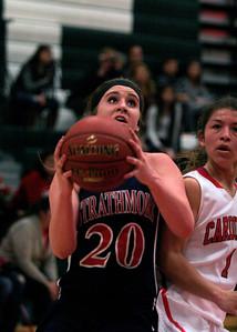 Strathmore Spartan Shelby Vanasen (20) drives by Lindsay Cardinal Destiny Garcia (1).