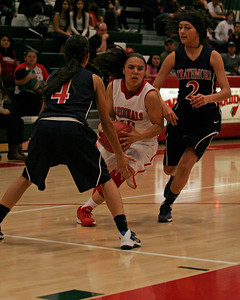 Lindsay's point guard Christina Castro (10) splits Strathmore defenders Abigail Rivera (4) and Mariah Hernandez (2) on her way to 20 points in the Cardinal's 58-38 playoff win over the Spartans.