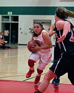 Christina Castro drives the key for 2 of her 20 points in the Cardinal's 58-38 playoff win over Strathmore on February 26th.