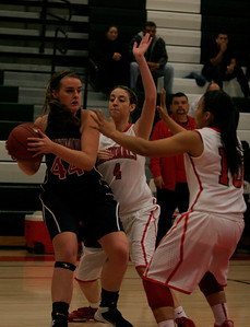Lindsay Cardinal players Ashley Baker (4) and Christina Castro (10) guard Strathmore's Coby Duffin in a CIF Central Section Division playoff game. Lindsay prevailed 58-38.