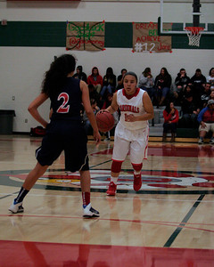 Lindsay Cardinal point guard bringd the ball up court against Lindsay. Castro had 20 points in the Cardinal's 58-38 win.