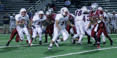 Cody Stiles (6) rushing with blocking from Ricky Meraz (75) and Juan Bravo (68).