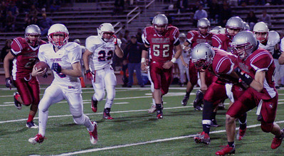 Cody Stiles (6) rushes against Granite Hills.