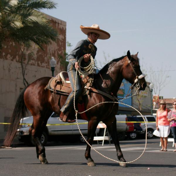 The Charros de la Federacioin Mexicana de Charreria entry in the 2014 OBF parade included a trick roper.