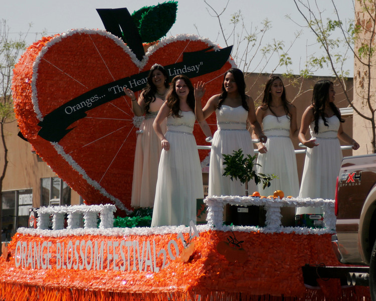The 2014 Orange Blossom Festival Queen Jocelyn Jauregui and her court (l to r) Yazmin Arellan, Christina Castro, Megan Salinas and Rebecca Macareno acknowledge the cheers of the crowd at the OBF parade.
