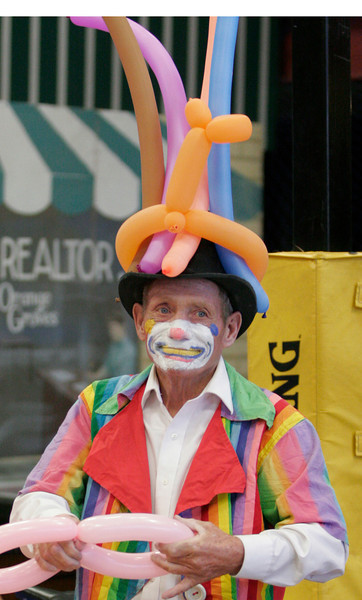 A clown made balloon creations for attendees at The Spirit and the Bride Kingdom Celebration on June 14, 2014 in Lindsay's McDermont Field House.