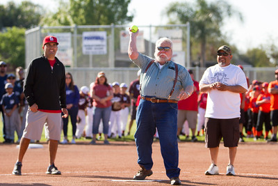 Ed Mecham, whose company helped pay for the new scoreboards at  Willow Court Park,  throws the ceremonial first  pitch to start the 2017 season of the Woodlake Youth Baseball and Softball league.