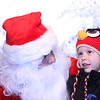 Rex (age 5) tells Santa all his wishes during the Woodlake Christmas Tree lighting ceremony.