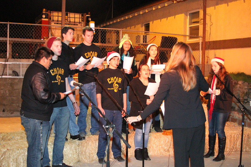 The Woodlake High School choir entertains the crowd with selections of Christmas carols during the annual Christmas tree lighting.