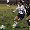 Farmersville MF Janette Rodriguez and Woodlake MF Briana Guerra scramble for the ball in their contest on December 2. The Farmersville Atzecs scored a 3-2 non-league win over Woodlake,