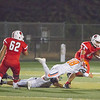 Woodlake CB Justin Hoskins (18) attempts to tackle Linsday TE Javier Avalos (44) in Friday night's contest. The Cardinals held on for a 14-12 win over the visiting Tigers in ESL action.