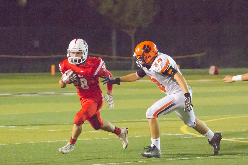 Lindsay RB Ethan Duran (28) tries to elude the tackle of Woodlake Tiger Angel Castillo (72). The Cardinals won their homecoming contest against the Tigers by a 14-12 score.