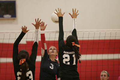 Woodlake's Regina Ramirez (23) and Melissa Samaniego (21) attempt to block a spike by Strathmore Spartan Coby Duffin (3) during their recent match.