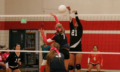 Woodlake Tiger middleblocker Melissa Samaniego attempts to block a hit by Strathmore's Kayla Holloway (7). Woodlake won the match 25-14, 25-18, 25-17.