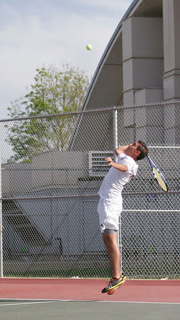 Woodlake Tiger No. 1 Seed, Bladamir Sanchez serves against Lindsay in their March 20, 2014 match at Linday.